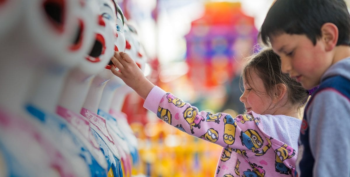 Girl playing on Laughing Clowns