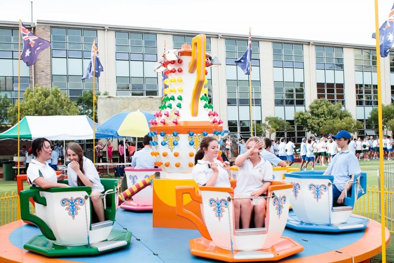 Students riding Tea Cups